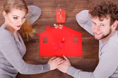 Couple on floor with symbols. Royalty Free Stock Photo