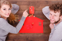 Couple on floor with symbols. Royalty Free Stock Images
