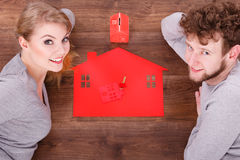 Couple on floor with symbols. Stock Images