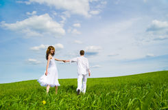 Couple in a flower field Royalty Free Stock Images