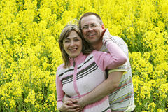 Couple in flower meadow Stock Photography