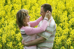 Couple in flower meadow Stock Image