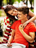 Couple with flower at park. Stock Photo