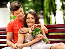 Couple with flower at park. Royalty Free Stock Photography