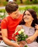 Couple with flower at park Royalty Free Stock Photos