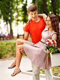 Couple with flower at park. Royalty Free Stock Images