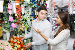 Couple in a flower shop Royalty Free Stock Image