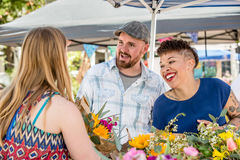 Couple with Flower Vendor at Famers Market Royalty Free Stock Image