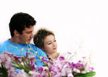 Couple with flowers. Sweet couple with flowers Stock Images