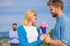 Couple with flowers bouquet romantic date. New love. Couple in love dating outdoor sunny day, sky background. Ex husband royalty free stock photography