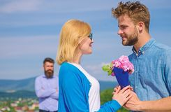Couple with flowers bouquet romantic date. New love. Couple in love dating outdoor sunny day, sky background. Ex partner stock images
