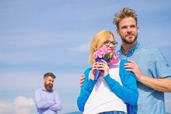 Couple with flowers bouquet romantic date. New love. Ex partner watching girl starts happy love relations. Ex husband stock image