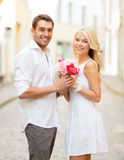 Couple with flowers in the city Royalty Free Stock Photo