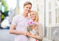 Couple with flowers in the city Royalty Free Stock Image