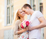 Couple with flowers in the city Stock Images