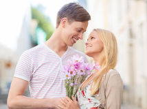 Couple with flowers in the city Royalty Free Stock Images