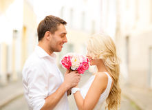Couple with flowers in the city Royalty Free Stock Photos