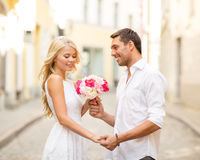 Couple with flowers in the city Stock Image