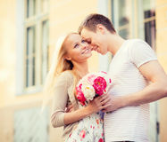 Couple with flowers in the city Stock Photo