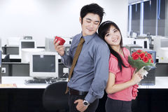 Couple with Flowers and Giftbox Stock Photos