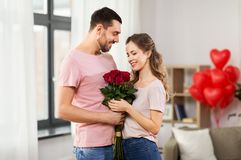 Couple with flowers at home on valentines day stock photos