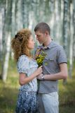 Couple with flowers in love hug in forest Stock Photos