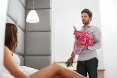 Couple with Flowers. Man Gives Flowers to his Girlfriend Stock Images