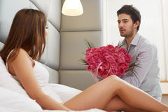 Couple with Flowers. Man Gives Flowers to his Girlfriend Stock Photo