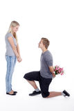 Couple with flowers and marriage proposal Royalty Free Stock Photos