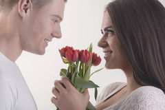 Couple with flowers. Summer holidays, love, relationship and dating concept - couple with bouquet of flowers Stock Images