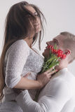 Couple with flowers Stock Photos