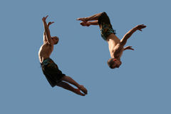 Couple of flying boys. An image of two flying young athletic men Stock Photography