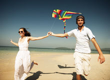 A couple flying a kite on the beach Royalty Free Stock Image