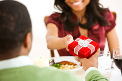 Couple: Focus on Bow on Gift Box Stock Image