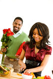 Couple: Focus on Woman Cooking Royalty Free Stock Image