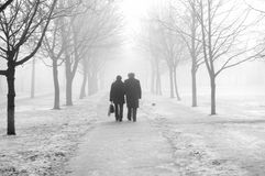 Couple in the fog Royalty Free Stock Photo