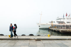 Couple in the foggy Istanbul, Turkey Stock Image