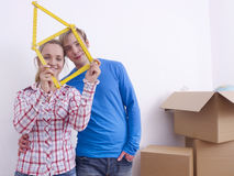 Couple with folding rule Stock Photography