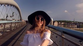 Couple follow me in Poland. Woman wanting her man to follow her in vacation or honeymoon. Attractive young woman in hat