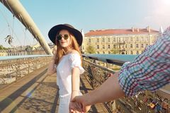 Couple follow me in Poland. Woman wanting her man to follow her in vacation or honeymoon. Attractive young woman in hat. Couple follow me in Poland. Woman royalty free stock photography