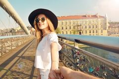Couple follow me in Poland. Woman wanting her man to follow her in vacation or honeymoon. Attractive young woman in hat. Couple follow me in Poland. Woman stock photos