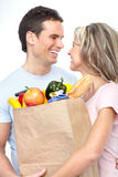 Couple  with food. Happy young couple carrying shopping bags with food Royalty Free Stock Image