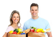 Couple  with food. Happy young couple carrying shopping bags with food Stock Photo