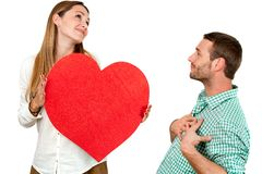 Couple fooling around with heart sign. Stock Images