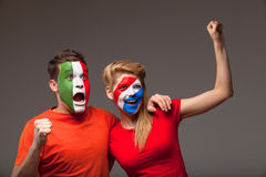Couple of footbal fans. Royalty Free Stock Photo