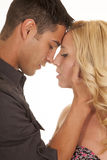 Couple foreheads touch close serious Royalty Free Stock Images