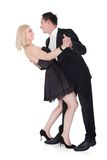 Couple In Formal Attire Dancing. Couple Dressed In Formal Attire Dancing Isolated Over White Background Royalty Free Stock Photo