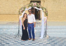 Couple formally dressed at a greek wedding. Happy couple formally dressed at a greek Orthodox wedding stock photos