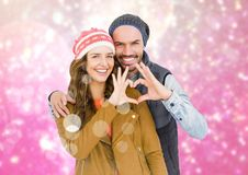 Couple forming heart shape with hands against digitally generated background Stock Photography