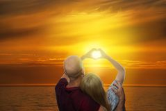 Couple Forming a Heart Stock Photos